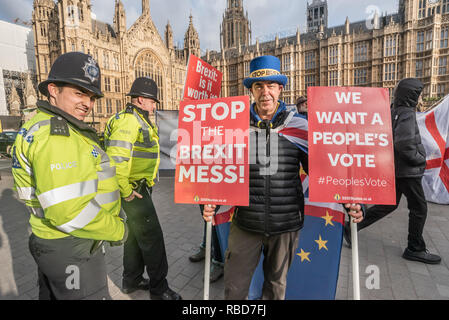 London, UK.  9th January 2019. Protests by stop Brexit group SODEM (Stand of Defiance European Movement) and pro-Brexit campaigners continue opposite Parliament. Steven Bray stands with police. Among the pro-Brexit campaigners were again some extreme-right 'yellow jackets', most of whom were fairly subdued. One man led a few others in shouting insults at SODEM protesters rather than and sensible protest, but some other Brexiteers had come to support Brexit rather than cause trouble. Police still seemed reluctant to act against possible breaches of public order. - Stock Image