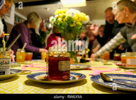 International Marmalade Festival, The Royal Oak Public House, Wirksworth, Derbyshire Dales, UK. 4th March, 2019. Participants bring & get stuck in tasting traditional homemade Seville and also other variants before voting on their favourite. Credit: Doug Blane/Alamy Live News - Stock Image