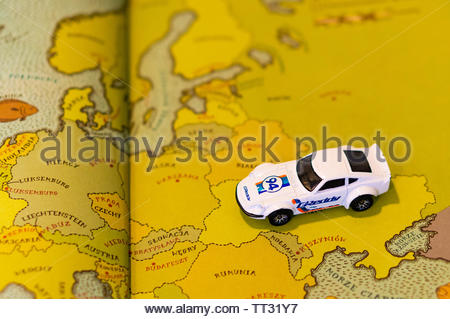 Mattel Hot Wheels white Nissan Fairlady car on a European map from a open educational book on circa June 2019 in Poznan, Poland. - Stock Image