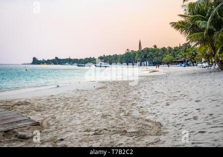 West Bay Beach early morning in Roatan Honduras.  Few people on the beach. - Stock Image
