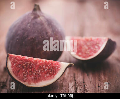 Organic common fig sliced on wooden surface - Stock Image