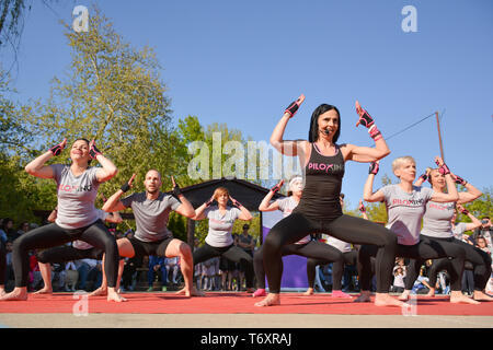 Nis, Serbia - April 20, 2019 Large group of happy people with instructor training Piloxing sport on sunny spring day - Stock Image