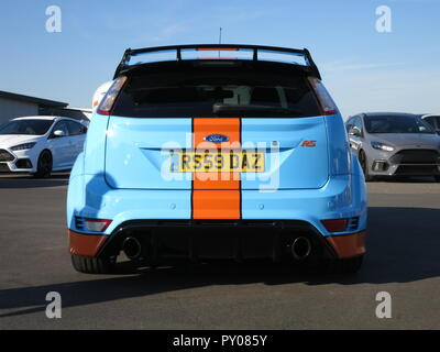 Ford Focus RS mk2 shown at donnington park race circuit at the RS owners club national day - custom paintwork in the style of the GT40 Gulf livery rear view with personalised number plate - Stock Image