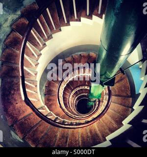 Looking down a spiral staircase - Stock Image