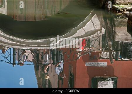 Reflections of people crossing bridge Ponte Zaguri near Campiello de la Feltrinella in Venice Italy  REFLECTIONS - Stock Image