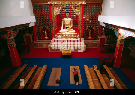Kaguypa Buddhist practitioner prostrating in a Tibetan Buddhist monastery Gompa - Stock Image
