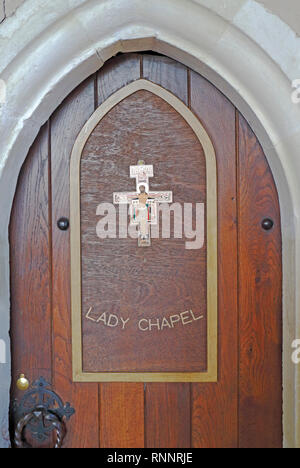 The door to the Lady Chapel in the parish church of the Holy Trinity and All Saints at Winterton-on-Sea, Norfolk, England, United Kingdom, Europe. - Stock Image