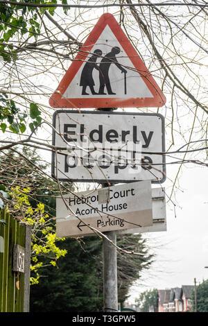 Elderly people road traffic sign, England, UK - Stock Image