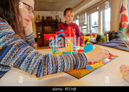 Mother and son (6 yr old) playing Mouse Trap board game - Stock Image