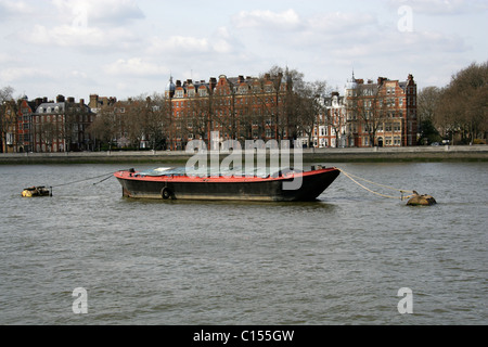 A Barge on the River Thames Opposite Chelsea Embankment, West London, UK. - Stock Image