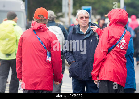 Portsmouth, UK. 26th July 2015. Volunteer 'Wavemakers' direct spectators away from the America's Cup - Stock Image