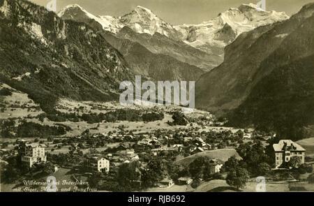 Interlaken, Wilderswil and three mountains (Eiger, Monch and Jungfrau), Bern, Switzerland. - Stock Image