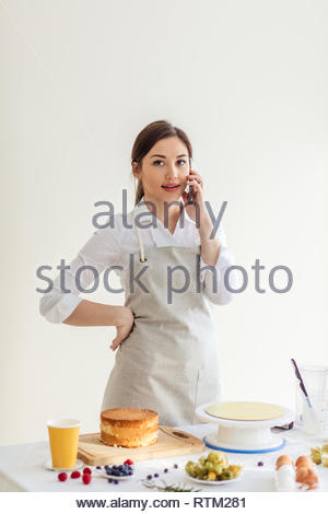 pleasant girl having a chat with her friend by mobile phone, close up photo. conversation concept - Stock Image