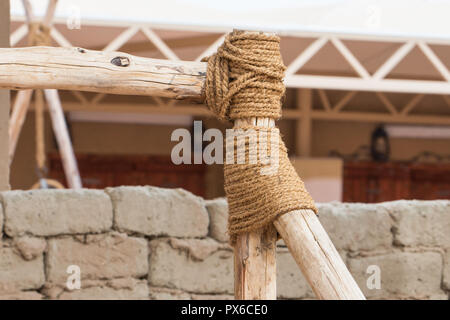 Connect the timber with a rope - Stock Image