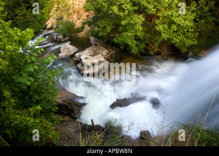 Water rushes over a waterfall along the Tanyard Creek Trail in Bella Vista, Ark. - Stock Image