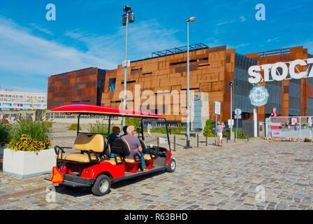 Golf cart electric transport for tourists, at former shipyard gate, Plac Solidarnosci, Gdansk, Poland - Stock Image