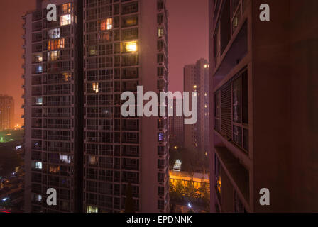 Apartment buildings in Beijing China at night - Stock Image