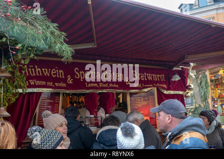 Dresden, Germany, December 14., 2018: Sales stand for mulled wine, bratwurst and meat specialities at the Strietzelmarkt - Stock Image