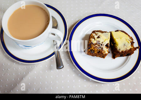 Afternoon snack in E. Botham's  famous Yorkshire Café in Whitby a cup of tea with a slice of buttered brack a local type of rich fruit cake - Stock Image