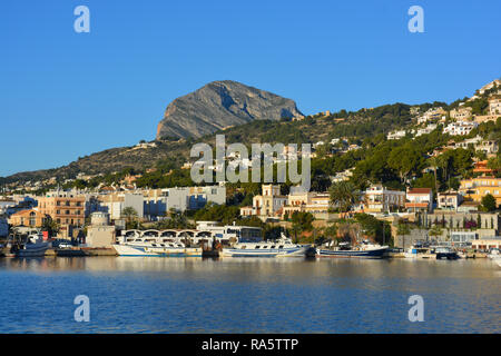 Early morning view to the port, villas on hillside and Montgo mountain in Javea on the Costa Blanca, Alicante province, Comunidad Valencia, Spain. - Stock Image