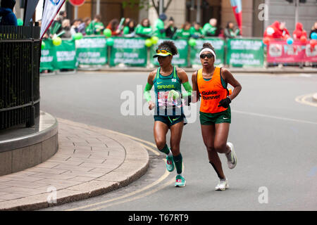 Edneusa de Jesus Santos Dorta with her guide runner, competing in the World Para 2019 London Marathon.  She went on to finish 2nd, in a time of 03:13:17 - Stock Image