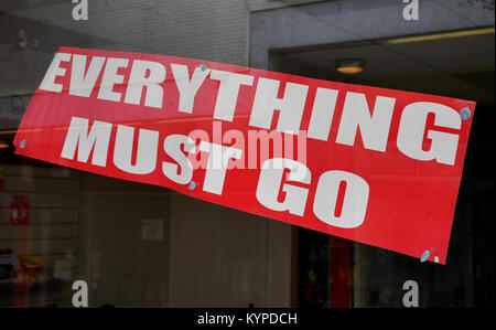 "Red ""Everything Must Go"", Sign in Window of closed down retail business in deserted shopping precinct, Crossways - Stock Image"