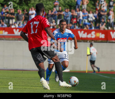 Stadium Carciato, Dimaro, Italy. 13th July, 2019. Pre-season football freindly, Napoli versus Benevento; Faouzi Ghoulam of Napoli breaks towards goal as Cristian Buonaiuto closes in to cover Credit: Action Plus Sports/Alamy Live News - Stock Image