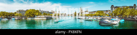 Panoramic view of historic Zurich city center with famous river Limmat at Lake Zurich on a sunny day with clouds in summer, Switzerland - Stock Image
