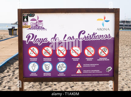 Notice showing list of prohibited activities on the Playa de Los Cristianos, Arona, Tenerife, Canary Islands - Stock Image