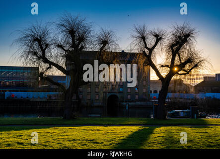 Winter sunset over the River Nene in central Peterborough, Cambridgeshire, England, UK - Stock Image