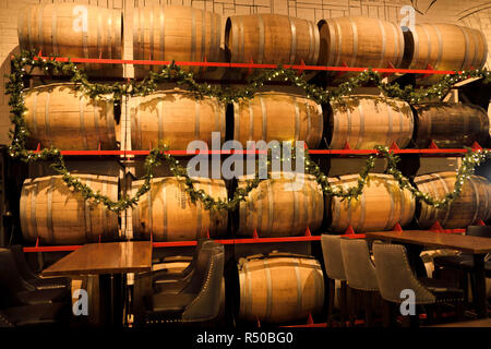 Amsterdam Brewhouse beer barrels on wall at this Toronto Harbourfront restaurant bar - Stock Image