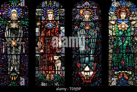 Four of seven saints, depicted by Harry Clark, above the sanctuary in the church of St. Oswald & St. Edmund, Ashton-in-Makerfield, Greater Manchester - Stock Image