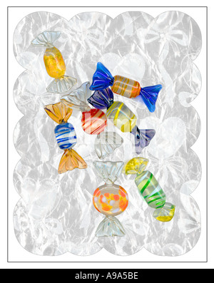 Collection of colourful Venetian glass sweets on a scalloped edged background of metallic wrapping paper - Stock Image