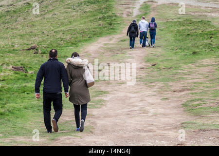 People enjoying a walk along The Warren on Pentire Point East in Newquay in Cornwall. - Stock Image
