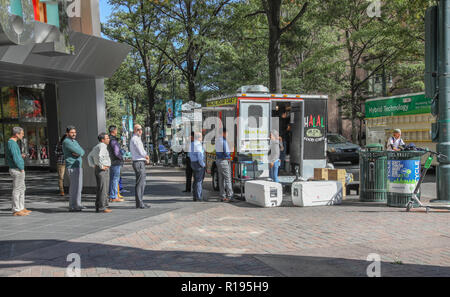 CHARLOTTE, NC, USA-10/30/18:  Customers waiting in line at a food cart on Tryon St. - Stock Image