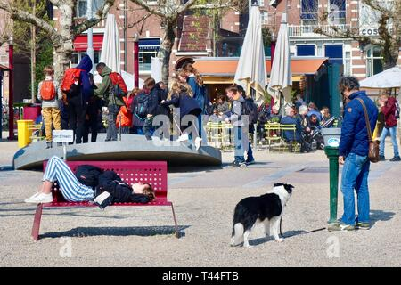 Amsterdam, Netherlands - April 2019: People relaxing at museumplein. - Stock Image