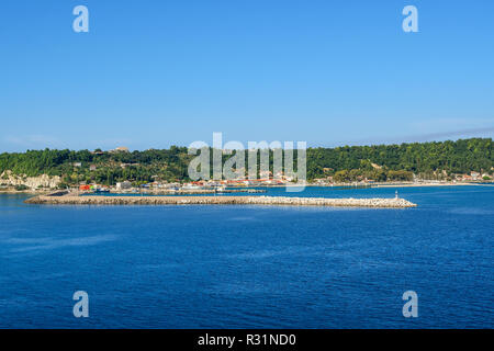 A view from the Ionian Sea of the Katakolon Olympia Greece coastal town and cruise Port of Call on a sunny summer day - Stock Image