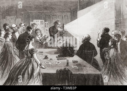 A demonstration of photography with the aid of a magnesium light to illuminate the subject, 1865.  From The Illustrated London News, published 1865. - Stock Image