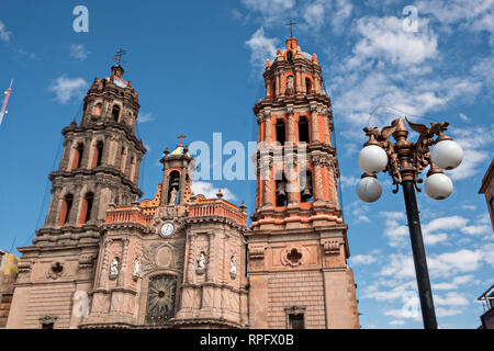 The Baroque facade of the Cathedral of San Luis Potosi in the historic center on the Plaza De Armas in the state capital of San Luis Potosi, Mexico. Also known as the San Luis Potosi Metropolitan Cathedral, it is consider the most important monument in the state and the first Baroque style building constructed in 1670 on the site of a parish church first built in 1593. - Stock Image
