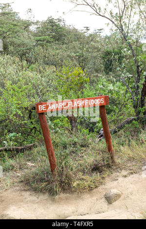 Be aware flash floods sign at Ol Njorowa gorge, Hells Gate National Park, Kenya - Stock Image