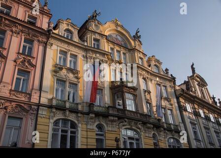 Historic buildings and Czech flag, Prague, Czech Republic - Stock Image