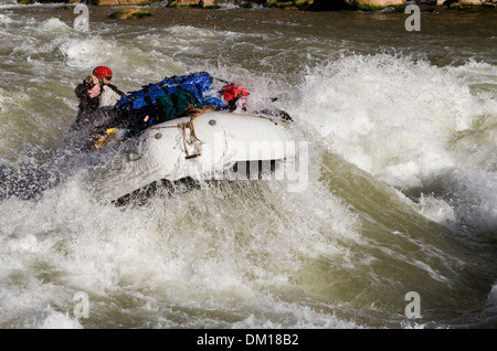 Rafting through white water rapids in the Grand Canyon. - Stock Image