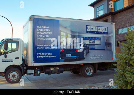 Delivery van parked at a residence in Pitt Meadows, B. C., Canada - Stock Image