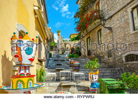 Colorful staircase located just off the main road in Taormina Italy, Corso Umberto, filled with ceramic art and pottery. - Stock Image