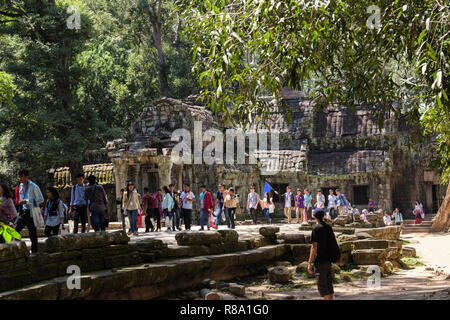 Large numbers of tourists at Ta Prohm Temple ruins in a jungle location. Siem Reap, Cambodia, southeast Asia - Stock Image