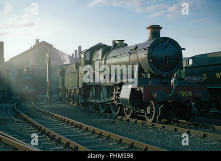 Ex GWR locomotive, ' Cookham manor' on shed at Didcot Railway centre in a re-created scene reminiscent of the days of steam. - Stock Image