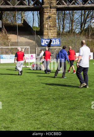 Middle-aged men taking part in a walking football session in Bolton, Lancashire, organised by  Bolton Wanderers - Stock Image
