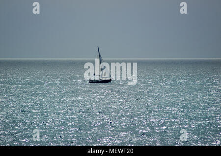 Isolated sailboat navigation on a calima day, an unusual weather condition in Tenerife, Canary Islands - Stock Image