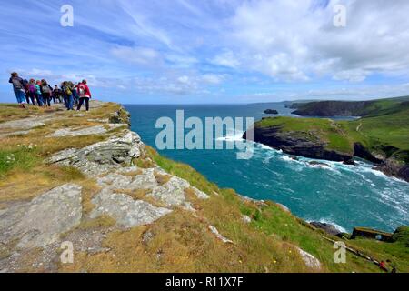 Tintagel Castle island peninsular, group of foreign students visiting the attraction,Cornwall,England ,UK - Stock Image