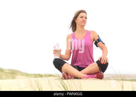 Young woman on the beach - Stock Image